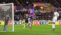 Leicester manager Claudio Ranieri makes a save during the Barclays Premier League match between Swansea City and Leicester City at the Liberty Stadium, Swansea on December 05 2015