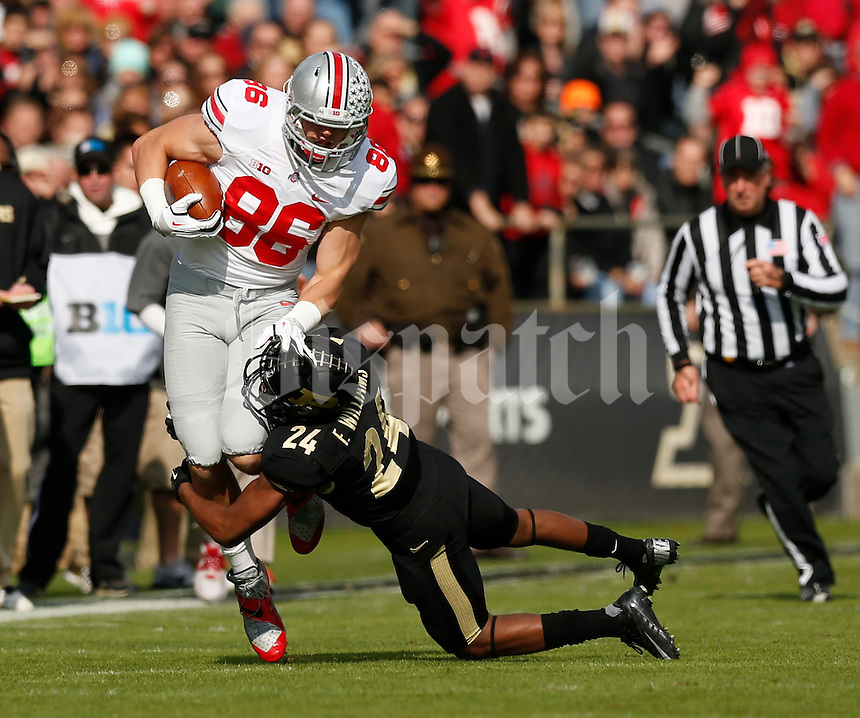 Ohio State Buckeyes tight end Jeff Heuerman (86) is tackled by Purdue Boilermakers defensive back Frankie Williams (24) during Saturday's NCAA Division I football game at Ross-Ade Stadium in West Lafayette, In. on November 2, 2013. (Barbara J. Perenic/The Columbus Dispatch)