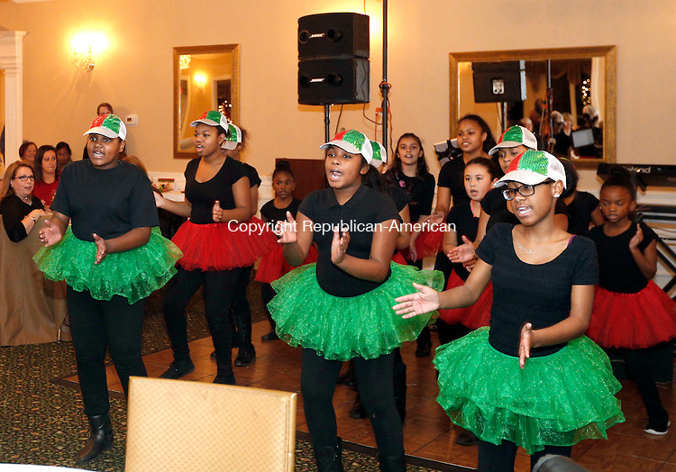 Waterbury, CT- 03 December 2015-120315CM11-  Girls from Waterbury Youth Services 4-H club perform a Christmas routine during a Santa's Workshop Toy Drive at The Country Club of Waterbury on Thursday.   Teenagers from Waterbury Youth Services built wooden rocking horses, train-shaped coat racks and other sturdy wooden crafts. Retired city shop teacher Billy Dwyer lead the woodworking program, one of several Waterbury Youth Services after-school programs.    Christopher Massa Republican-American
