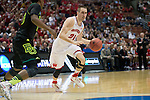 Wisconsin Badgers guard Josh Gasser (21) handles the ball during  a regional semifinal NCAA college basketball tournament game against the Baylor Bears Thursday, March 27, 2014 in Anaheim, California. The Badgers won 69-52. (Photo by David Stluka)