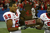 January 5th, 2008:  Rutgers players Gaudhi DeSedas (59) and Marcus Daniels (9) pose with the championship trophy after the International Bowl at the Rogers Centre in Toronto, Ontario Canada...Rutgers defeated Ball State 52-30.  ..Photo By:  Mike Janes Photography