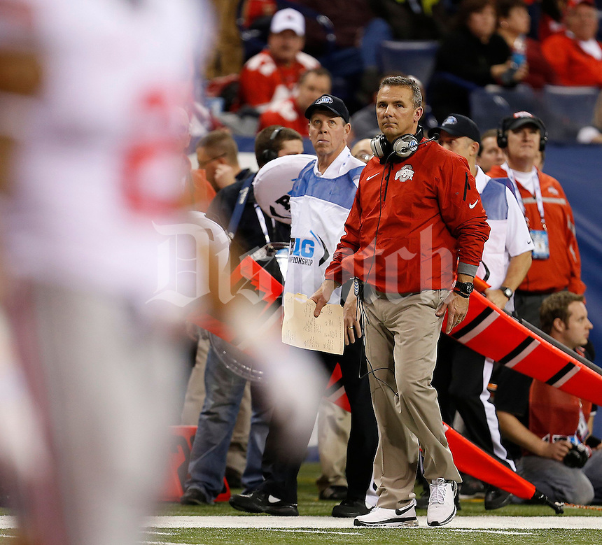 Ohio State Buckeyes head coach Urban Meyer reacts to the 3rd Michigan State scoring play during the first half of the Big Ten Championship football game at Lucas Oil Stadium in Indianapolis on Friday, December 7, 2013. (Columbus Dispatch photo by Jonathan Quilter)
