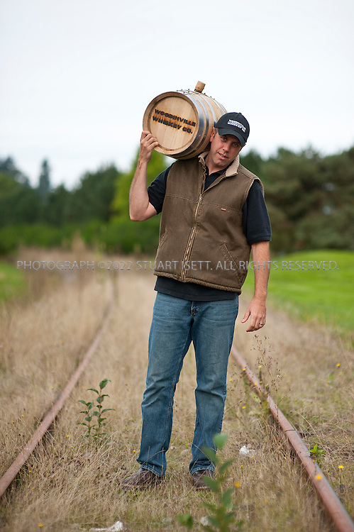 10/14/2011--Woodinville, WA, USA..The Woodinville Whiskey Company located in Woodinville, WASH., about 20 miles east of Seattle.  Owners Orlin Sorensen (seen here carrying a barrel)  offers tours and tastings of the distillery...©2011 Stuart Isett. All rights reserved.