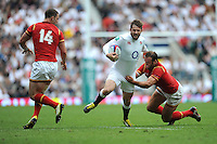 Elliot Daly of England is tackled by Jamie Roberts of Wales during the Old Mutual Wealth Cup match between England and Wales at Twickenham Stadium on Sunday 29th May 2016 (Photo: Rob Munro/Stewart Communications)