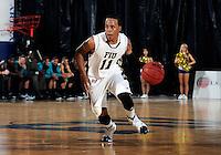 Florida International University guard Phil Taylor (11) plays against Coastal Carolina University.  FIU won the game 64-62 on November 26, 2011 at Miami, Florida. .