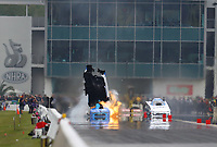 Mar 16, 2019; Gainesville, FL, USA; NHRA funny car driver Tommy Johnson Jr (left) explodes the body off his car alongside John Force during qualifying for the Gatornationals at Gainesville Raceway. Mandatory Credit: Mark J. Rebilas-USA TODAY Sports