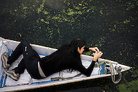 Suzanne Lee filming in a shikara boat with the Sony ActionCam POV cameras while on a motorcycle ride Across the Indian Himalayas with Sanjit Das on Royal Enfield motorcycles. Photo by Sanjit Das/Panos Pictures