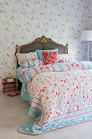 In the bedroom, the romantic aesthetic is very much inspired by Janneke's previous work for the shop 'Oilily'. Even the bedspread is made from shop window fabric from the store