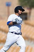 Glendale Desert Dogs catcher Keibert Ruiz (17), of the Los Angeles Dodgers organization, jogs towards first base during an Arizona Fall League game against the Mesa Solar Sox at Camelback Ranch on October 15, 2018 in Glendale, Arizona. Mesa defeated Glendale 8-0. (Zachary Lucy/Four Seam Images)