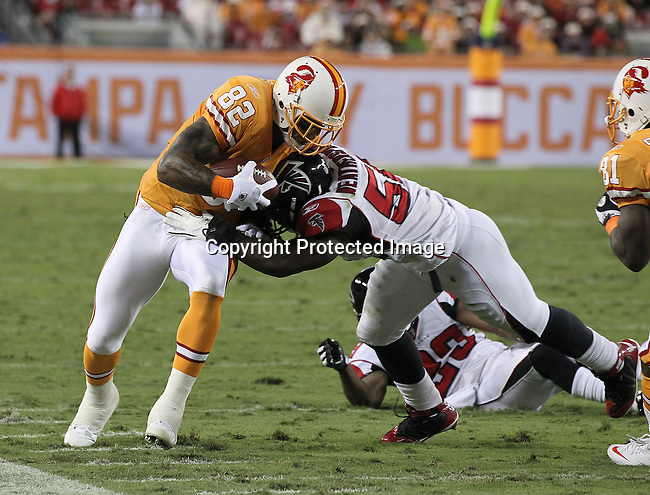 Tampa Bay Buccaneers tight end Kellen Winslow (82) gets a first down as Atlanta Falcons linebacker Sean Weatherspoon (56) pushes him out of bounds during an NFL football game Sunday in Tampa, Fla, December 5, 2010. The Falcons defeated the Buccaneers 28-24. (AP/Margaret Bowles)