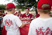 STANFORD, CA - April 23, 2011: Jordan Pries of Stanford baseball talks to a fan during an autograph signing after Stanford's game against UCLA at Sunken Diamond. Stanford won 5-4.