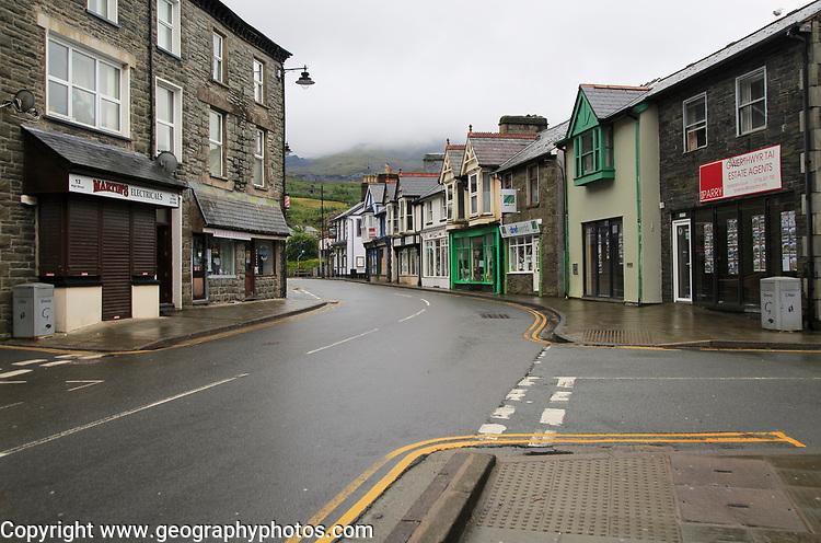 Shops on main high street on a wet day,  Blaenau Ffestiniog, Gwynedd, north Wales, UK