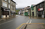 Shops on main high street on a wet day,  Blaenau Ffestiniog, Gwynedd, north Wales, UK