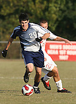 10 November 2007: Duke's Joshua Medcalf (in blue) is chased by NC State's Orry Powers (behind). The Duke University Blue Devils defeated the North Carolina State University Wolfpack 2-0 at Method Road Soccer Stadium in Raleigh, North Carolina in an Atlantic Coast Conference NCAA Division I Men's Soccer game.