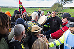 © Joel Goodman - 07973 332324 . 08/10/2016 . Lancashire , UK . Demonstrators at the gate to farmland on Preston New Road on which the permission to frack has been granted . Anti fracking demonstration against the government and fracking firm Cuadrilla at Maple Farm on Preston New Road near Preston in Lancashire , following Communities and Local Government Minister Sajid Javid's decision to overturn Lancashire County Council's decision to ban fracking on the site . Photo credit : Joel Goodman
