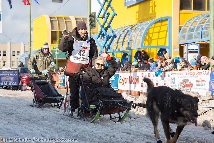 Richie Diehl and team leave the ceremonial start line with an Iditarider at 4th Avenue and D street in downtown Anchorage, Alaska during the 2015 Iditarod race. Photo by Jim Kohl/IditarodPhotos.com