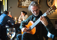 Stephen Lyman, composer, guitarist and expert on Bach, playing the Bach Lute Suite and other pieces of music at Le Fumoir, 6 Rue de l'Amiral de Coligny, Paris. Tuesday 26th March 2013.