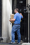 © Joel Goodman - 07973 332324 . 12/06/2013 . London , UK .  A delivery from Internet retailer , Amazon , being delivered to 10 Downing Street this morning (Wednesday 12th June) . Amazon earns more through government grants than it pays in tax and it has been criticised for Corporation Tax avoidance . Photo credit : Joel Goodman
