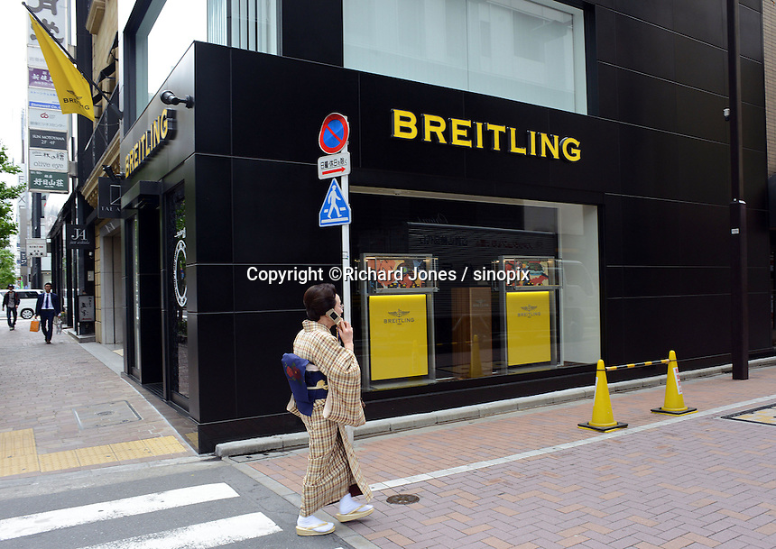 A Japanese shopper wears a Kimonos in the up-market shopping district,  Ginza, Tokyo, Japan.<br /> April-2014