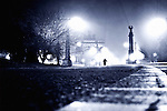 Alone - foggy night in Brooklyn, New York City, with lone person standing on the street.