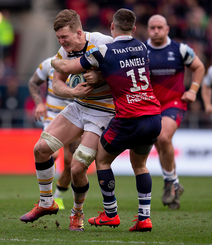 Worcester's Ted Hill is tackled by Bristol's Luke Daniels<br /> <br /> Photographer Bob Bradford/CameraSport<br /> <br /> Gallagher Premiership - Bristol Bears v Worcester Warriors - Saturday 23rd March 2019 - Ashton Gate - Bristol<br /> <br /> World Copyright © 2019 CameraSport. All rights reserved. 43 Linden Ave. Countesthorpe. Leicester. England. LE8 5PG - Tel: +44 (0) 116 277 4147 - admin@camerasport.com - www.camerasport.com