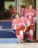 Meghan Riggs (BU - 5), Carly Warren (BU - 6) - The Boston University Terriers defeated the visiting Northeastern University Huskies 3-2 on Saturday, January 28, 2012, at Agganis Arena in Boston, Massachusetts.