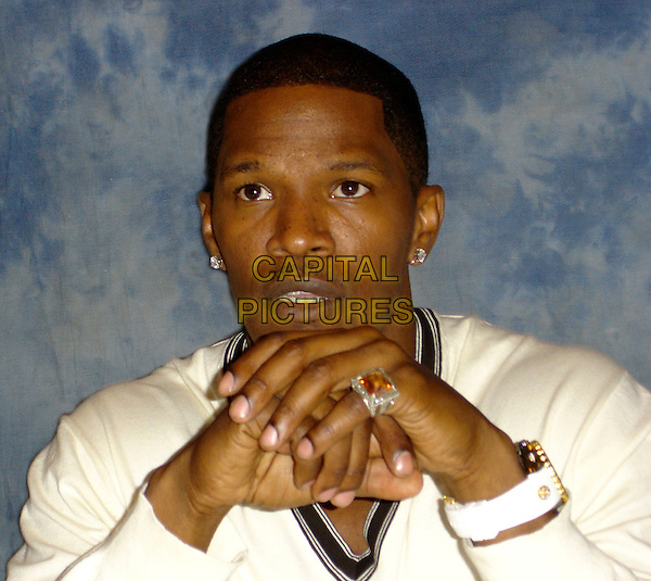 "JAMIE FOXX.""Miami Vice"" Press Conference,.Four Seasons Hotel,  Beverly Hills, California , USA,.July 14th 2006..portrait headshot hands ring.Ref: AW.www.capitalpictures.com.sales@capitalpictures.com.©Anita Weber/Capital Pictures."