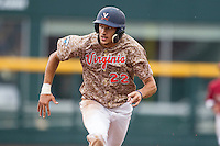 Virginia Cavaliers shortstop Daniel Pinero (22) runs to third base against the Arkansas Razorbacks in Game 1 of the NCAA College World Series on June 13, 2015 at TD Ameritrade Park in Omaha, Nebraska. Virginia defeated Arkansas 5-3. (Andrew Woolley/Four Seam Images)