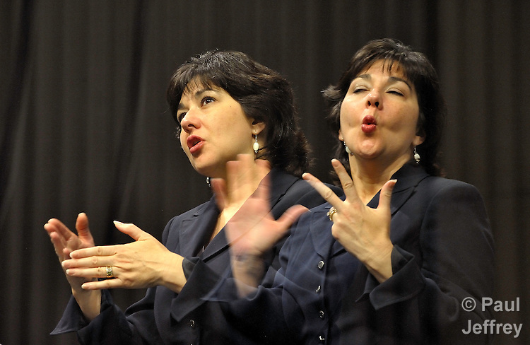 A double exposure of Michelle Menefee, a member of First United Methodist Church in Houston, Texas, as she interprets the proceedings of the denomination's 2008 General Conference in American Sign Language.