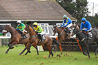 Milreu left ridden by Tom Scudamore leads the field over the last first time around during Horse Racing at Plumpton Racecourse on 10th February 2020