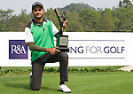 Abhijit Chadda of India poses with the trophy after winning the 2011 Faldo Series Asia Grand Final on the Faldo Course at Mission Hills Golf Club in Shenzhen, China. Photo by Victor Fraile / Faldo Series