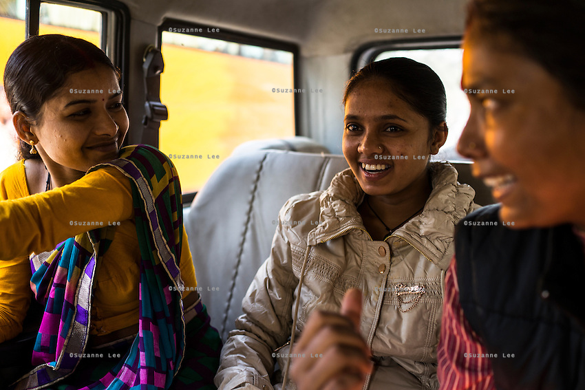 (left to right) Brinda, Saroj and Santwana Manju of Guria laugh in the car while going out for a day of shopping fun as a method of therapy, in Varanasi, Uttar Pradesh, India on 24 November 2013. Manju takes the girls under the witness protection program out shopping once in a few months to ease their minds and help them prepare for the court appearances.