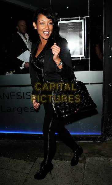 LISA MAFFIA .The Anesis Spa VIP Launch, The Pavement, London, 13th January 2011..full length black bag jacket leggings .CAP/CAN.©Can Nguyen/Capital Pictures.