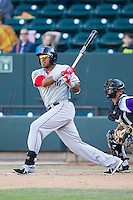 Mario Martinez (47) of the Salem Red Sox follows through on his swing against the Winston-Salem Dash at BB&T Ballpark on April 20, 2014 in Winston-Salem, North Carolina.  The Dash defeated the Red Sox 10-8.  (Brian Westerholt/Four Seam Images)