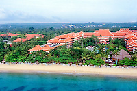 Bali, Badung, Nusa Dua. Hotels on Nusa Dua, Bali. Nusa Dua is relatively flat compared to the rest of the Bukit peninsula (from helicopter).