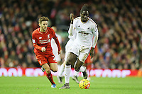 Swansea City's Eder and Liverpool's Adam Lallana during the Barclays Premier League match between Liverpool and Swansea City played at The Anfield Stadium on November 29th 2015