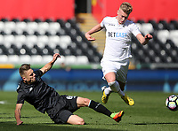 SWANSEA, WALES - MARCH 25:Adam King of Swansea City is tackled by Oleg Reabciu of Porto during the Premier League International Cup Semi Final match between Swansea City and Porto at The Liberty Stadium on March 25, 2017 in Swansea, Wales. (Photo by Athena Pictures)