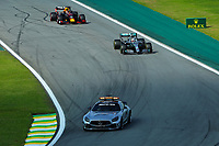 17th November 2019; Autodromo Jose Carlos Pace, Sao Paulo, Brazil; Formula One Brazil Grand Prix, Race Day; Safety Car out as Lewis Hamilton (GBR) Mercedes AMG F1 W10 and Max Verstappen get ready to launch late in the race - Editorial Use