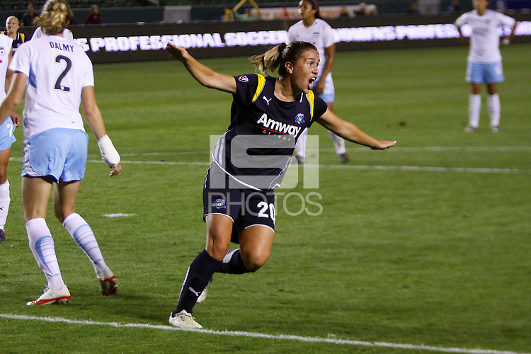 Camille Abily #20 of the Los Angeles Sol celebrates after scoring the game tying goal against the Chicago Red Stars during their WPS game at The Home Depot Center on June 3,2009 in Carson, California.  The Sol and Red Stars tied 1-1.