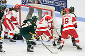 Players battled for a puck on the side of the net. - The Boston University Terriers tied the visiting University of Vermont Catamounts 2-2 on Saturday, November 13, 2010, at Walter Brown Arena in Boston, Massachusetts.