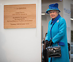 © Joel Goodman - 07973 332324 . 14 November 2013 . Manchester , UK . The Queen unveils the official opening plaque . Queen Elizabeth II and the Duke of Edinburgh visit the Coop building at 1 Angel Square , Manchester , this morning ( 14th November 2013 ) . Photo credit : Joel Goodman