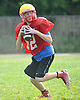 East Islip No. 12 Devin Olsen looks for an open receiver during football team practice at the high school on Wednesday, August 19, 2015.