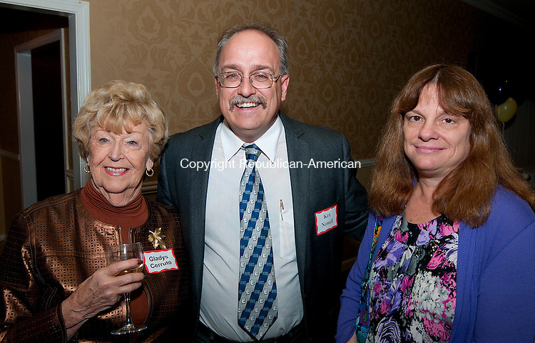 TORRINGTON, CT-110514JS24- Gladys Curruto, left, with Ken and Karen Nowell during the final night celebration for the United Way of Northwest Connecticut's annual campaign at P. Sam's Restaurant in Torrington.<br />   Jim Shannon Republican-American
