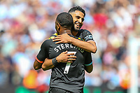Raheem Sterling of Manchester City celebrates after he scores with Riyad Mahrez of Manchester City during the Premier League match between West Ham United and Manchester City at the London Stadium, London, England on 10 August 2019. Photo by David Horn.