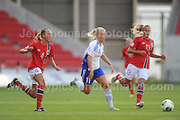 Adelina Engman of Finland battles with Carlotta Fennefoss  and Andrine Tomter of Norway during the UEFA Womens U19 Championships at Parc y Scarlets, Monday 19th August 2013. All images are the copyright of Jeff Thomas Photography-www.jaypics.photoshelter.com-07837 386244-Any use of images must be authorised by the copyright owner.