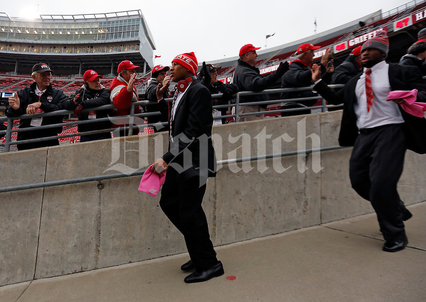 Ohio State Buckeyes linebacker Ryan Shazier (2) high-fives ushers as the team walks into the stadium before their game against Penn State Nittany Lions at Ohio Stadium on October 26, 2013.  (Dispatch photo by Kyle Robertson)