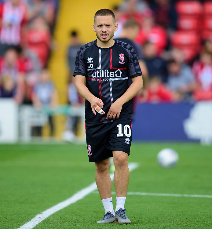 Lincoln City's Jack Payne during the pre-match warm-up<br /> <br /> Photographer Andrew Vaughan/CameraSport<br /> <br /> The EFL Sky Bet League One - Lincoln City v Fleetwood Town - Saturday 31st August 2019 - Sincil Bank - Lincoln<br /> <br /> World Copyright © 2019 CameraSport. All rights reserved. 43 Linden Ave. Countesthorpe. Leicester. England. LE8 5PG - Tel: +44 (0) 116 277 4147 - admin@camerasport.com - www.camerasport.com