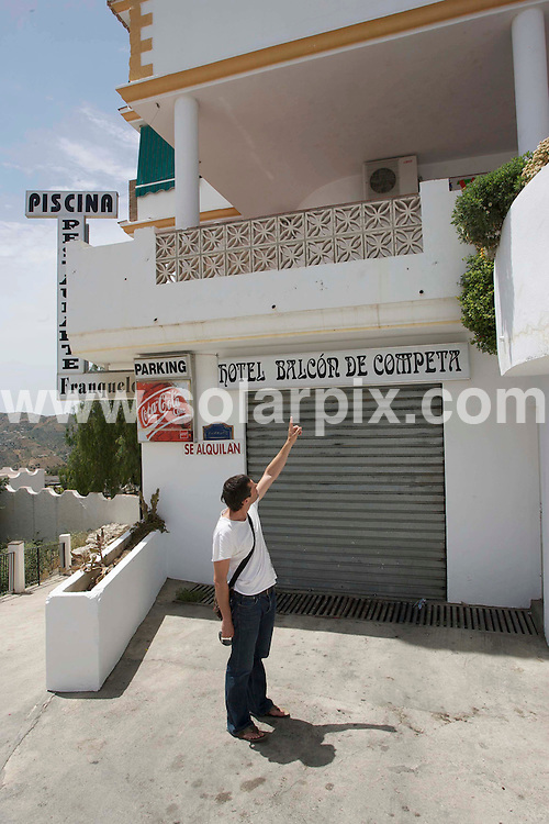 """**ALL ROUND EXCLUSIVE PICTURES FROM SOLARPIX.COM**.**WORLDWIDE SYNDICATION RIGHTS**.British holiday maker Stephen Mallom was involved in a brawl with some local lads after leaving the """"La Estrealla late night bar in the Spanish mountain Village of """"Competa"""" near Malaga. The fight ended in him falling from a 15ft high terrace to a Hotel garage. entrance below..Stephen is now in a Coma at the Carlos Haya Hospital in Malaga...This pic: Terrace balcony above garage entrance where Stephen fell during the fight.(Reporter Gerard Couzens showing the balcony f where Stephen feelfrom...JOB REF: 9223       AB1       DATE:13.06.09.**MUST CREDIT SOLARPIX.COM OR DOUBLE FEE WILL BE CHARGED**.**ONLINE USAGE FEE GBP 50.00 PER PICTURE - NOTIFICATION OF USAGE TO PHOTO @ SOLARPIX.COM**.**CALL SOLARPIX : +34 952 811 768 or LOW RATE FROM UK 0844 617 7637**"""