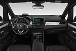 Stock photo of straight dashboard view of a 2018 BMW bmw 2activetourluxmv1fb 5 Door Mini Van