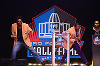 Canton, OH - August 4, 2018:  Former Baltimore Ravens' tackle and Hall of FamerJonathan Ogden does the squirrel dance with Ray Lewis during Lewis' Pro Football Hall of Fame enshrinement speech, August 4, 2018, at the Tom Benson stadium.  (Photo by Don Baxter/Media Images International)